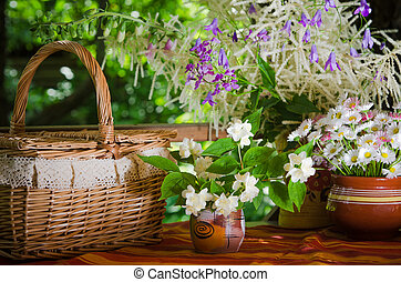 A bouquet of daisies in a pot on the table for a picnic