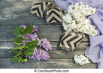 A bouquet of lilac flowers on an old wooden surface