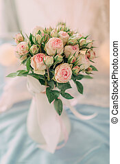 A bouquet of pink roses in a vase