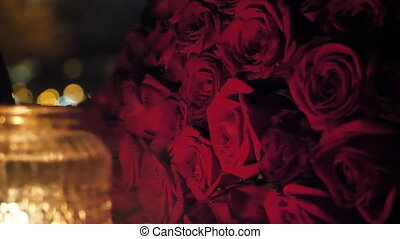 A bouquet of red roses candlelight - Romantic background for...