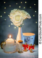 a bouquet of roses with candle for Valentine