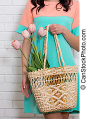 A bouquet of tulips in a basket