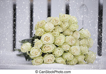 A bouquet of white roses snow white snow