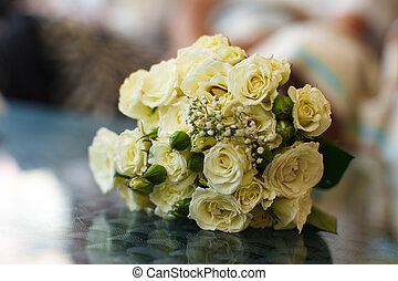 A bouquet of yellow roses with green buds