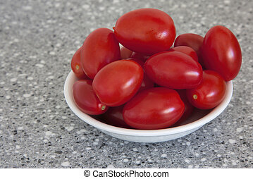 grape tomatoes - a bowl full of small red grape tomatoes...