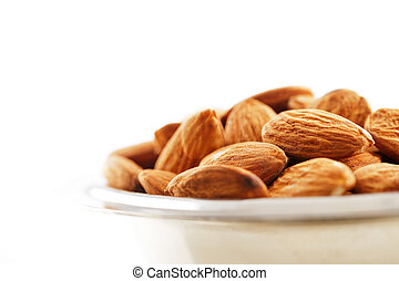 A bowl of almonds on white