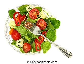 A bowl of fresh colorful salad and a fork isolated