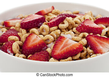 healthy cereal rings with sliced strawberries
