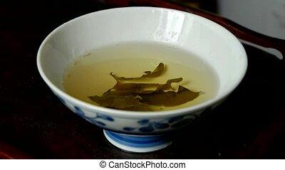 A bowl of steaming tea. china, japan,