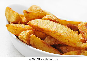 a bowl with home fries on a white background