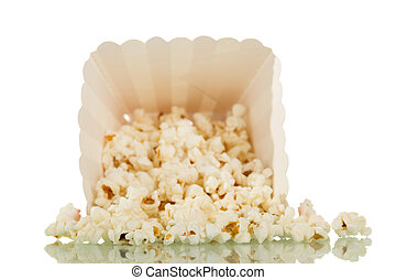 A box fell with popcorn and crumbled, isolated on white...