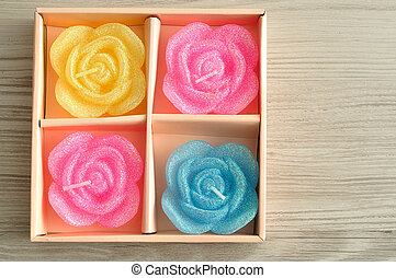A box of candles in the shape of roses