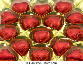 a box of chocolates in the shape of hearts