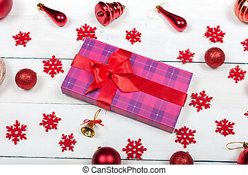 A box tied with a red ribbon