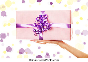 A box tied with a violet satin ribbon bow.