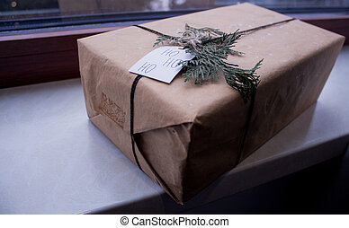 box with a gift near the window