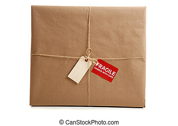 A box wrapped in brown paper with blank tag - a Box wrapped...