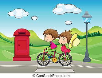 A boy and a girl biking