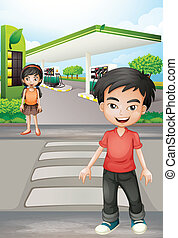 A boy and a girl near the gasoline station