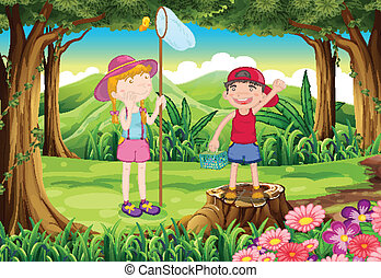 A boy and a girl playing at the forest