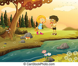 A boy and a girl playing at the forest near the riverbank