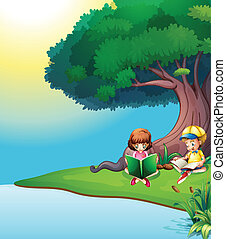 A boy and a girl reading under the tree