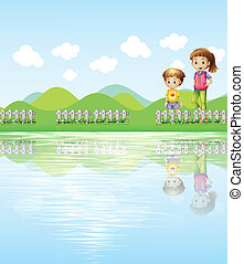 A boy and a girl watching the lake