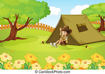 A boy and camping tent