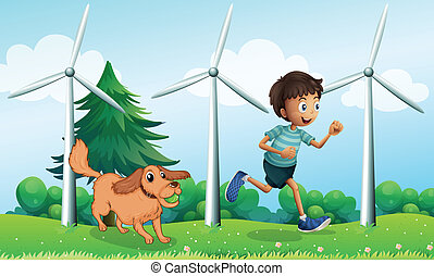 A boy and his dog near the three windmills