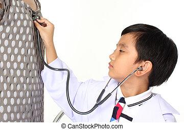 boy as doctor examining a girl