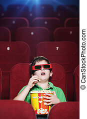 A boy at the 3D cinema
