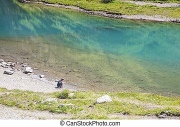 A boy at the alpine lake