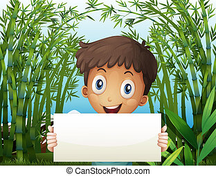 A boy at the bamboo farm holding an empty signage