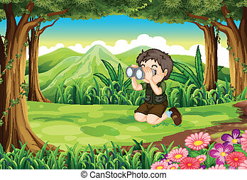 A boy at the forest with a telescope