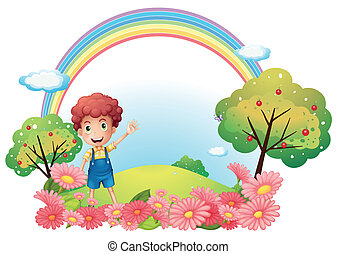 A boy at the hill with a rainbow