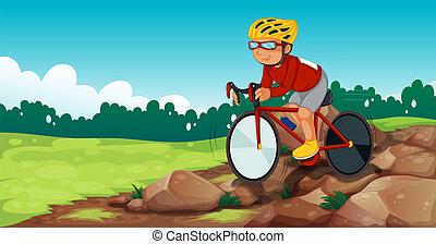 A boy biking at the rocky road