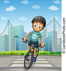 A boy biking in the city