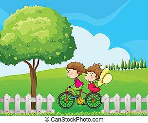 A boy biking with his girlfriend
