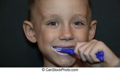 A boy brushing his teeth