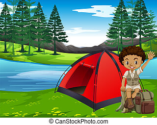 A boy camping in forest