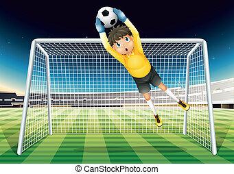 A boy catching the soccer ball