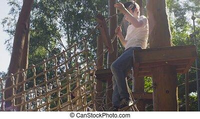 A boy climbing on a playground equipment