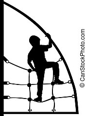 a boy climbing on the jungle gym
