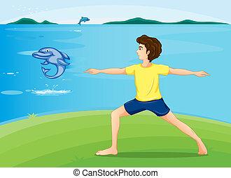 A boy exercising at the riverbank