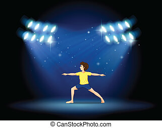 A boy exercising at the stage with spotlights