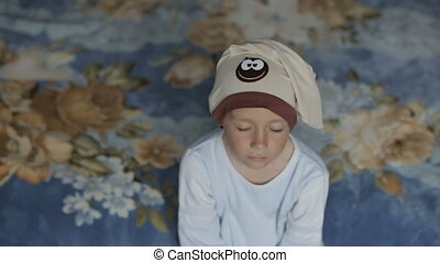 A boy fell asleep while sitting on the couch. - Little boy...