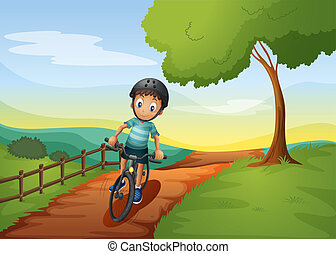 A boy going to the farm with his bike