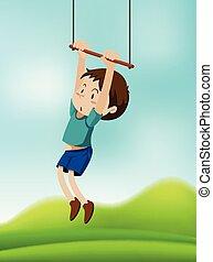 A boy hanging on swing