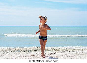 A boy having fun on the beach.