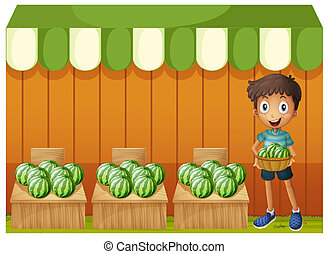 A boy holding a basket of watermelons